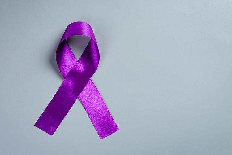 purple-ribbon-wooden-surface